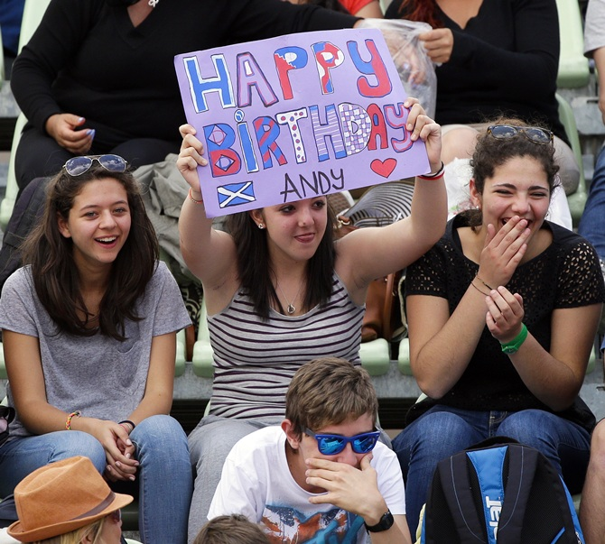 A fan of Andy Murray of Britain holds a banner wishing him 'Happy birthday'
