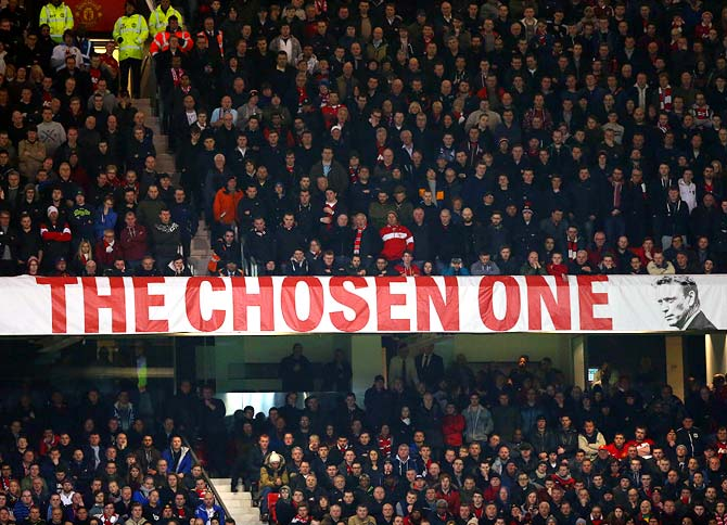 Manchester United fans display a David Moyes banner