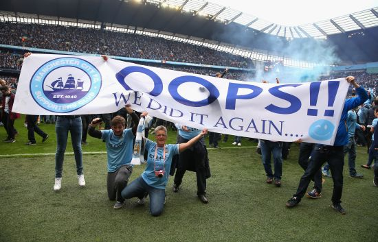 Manchester City fans celebrate at the end of the Barclays Premier League match