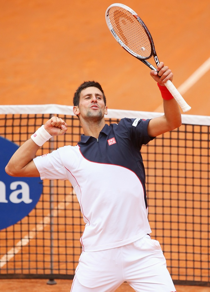 Novak Djokovic of Serbia celebrates defeating David Ferrer