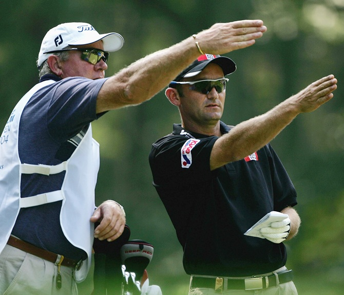 Markus Brier of Austria with caddy Iain McGregor