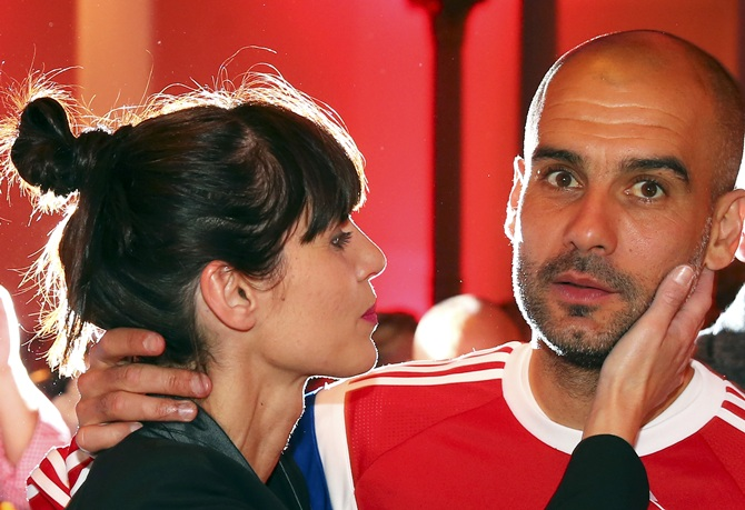 Bayern Munich's coach Pep Guardiola and his wife Cristina Serra