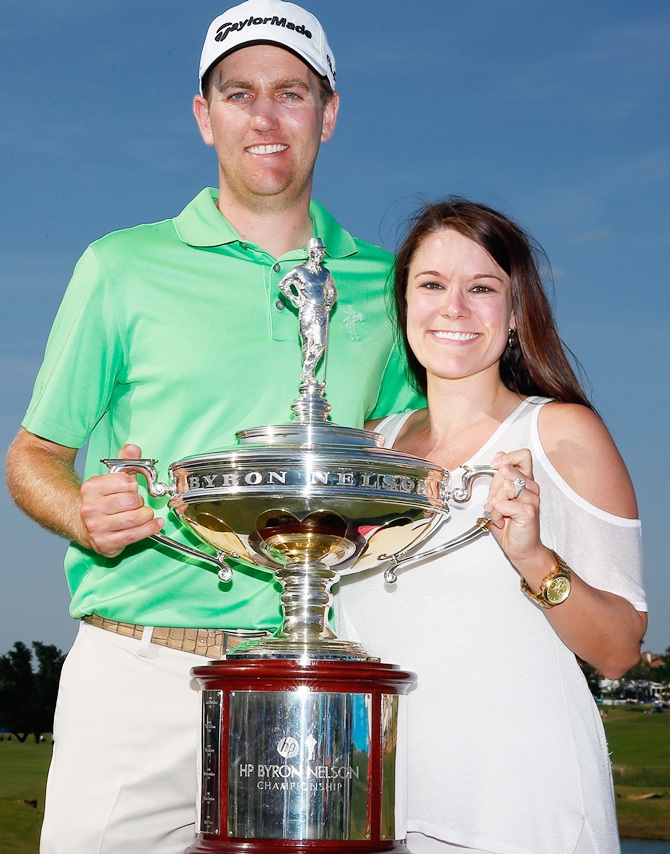 Brendon Todd,left, poses with his wife Rachel Todd holding the trophy after   his victory at the HP Byron Nelson Championship at the TPC Four Seasons Resort