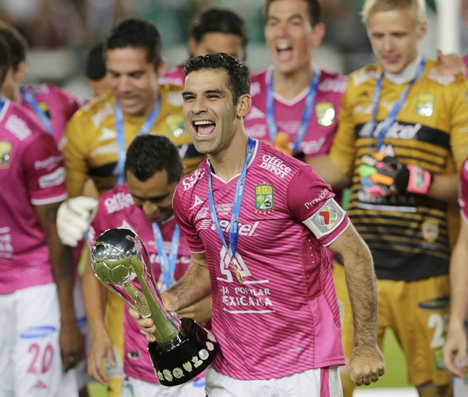 Rafael Marquez,centre, of Leon holds up the trophy after their team won the Mexican league championship final