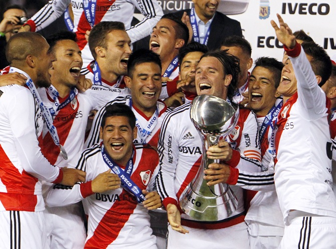 River Plate's players celebrate with the trophy after winning the Argentine first division soccer championship