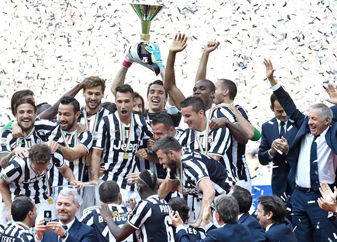 The Juventus FC players celebrate with the Serie A trophy