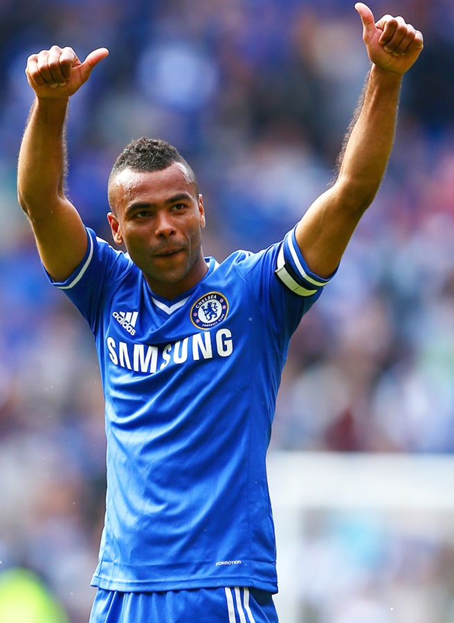 Ashley Cole of Chelsea gives a thumbs up to the fans