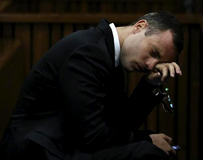 Oscar Pistorius breaks down during his trial at the high court in Pretoria