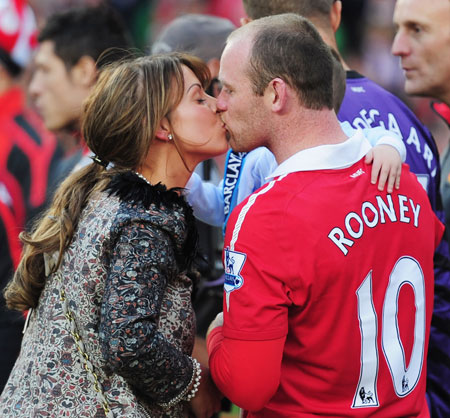 Coleen Rooney kisses husband Wayne