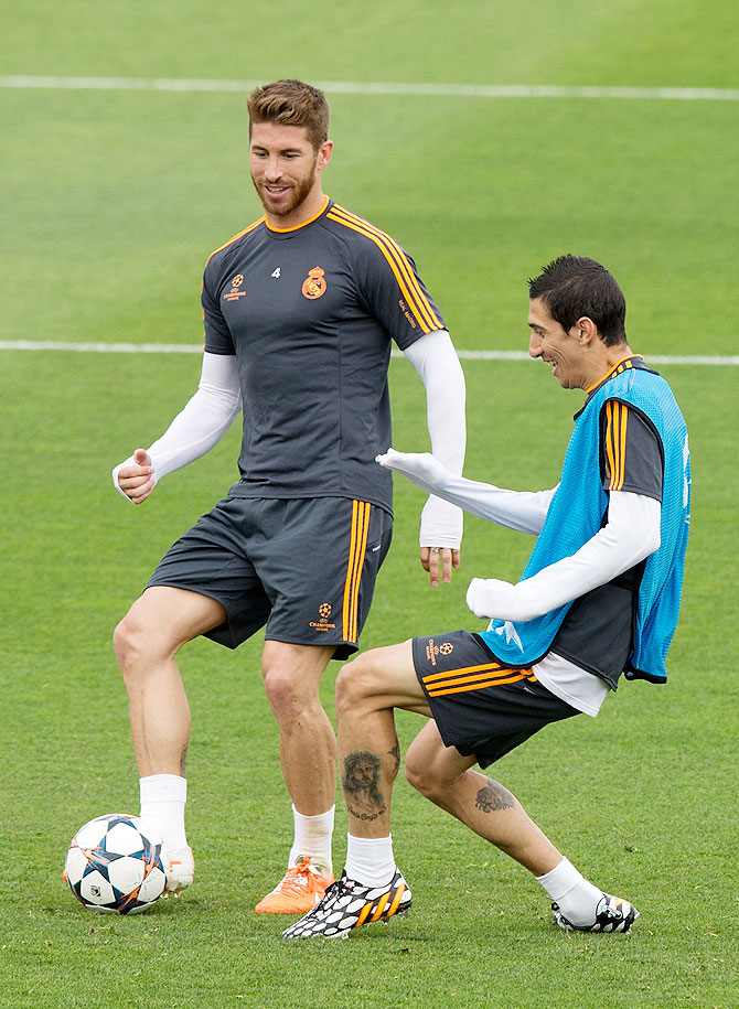 Angel Di Maria (right) of Real Madrid CF competes for the ball with team-mate Sergio Ramos during a training session on the Real Madrid media day, prior to UEFA Champions League final against Club Atletico de Madrid, at Valdebebas Sport City on Tuesday