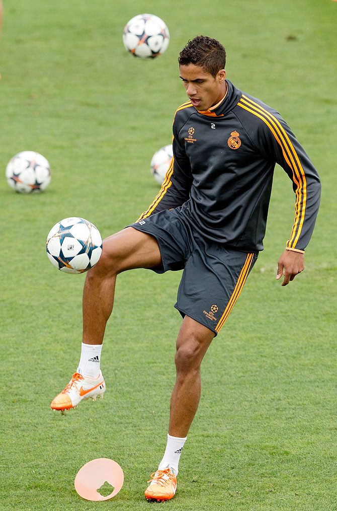 Raphael Varane of Real Madrid CF controls the ball during the training session held the Real Madrid media day on Tuesday