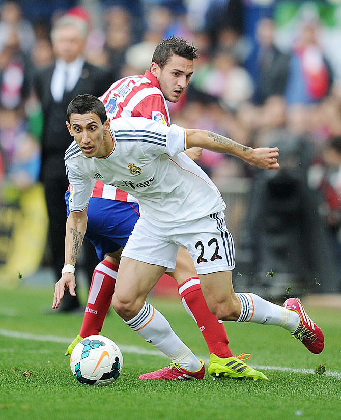 Angel Di Maria (#22) of Real Madrid CF challenges Koke of Club Atletico de Madrid during the La Liga match