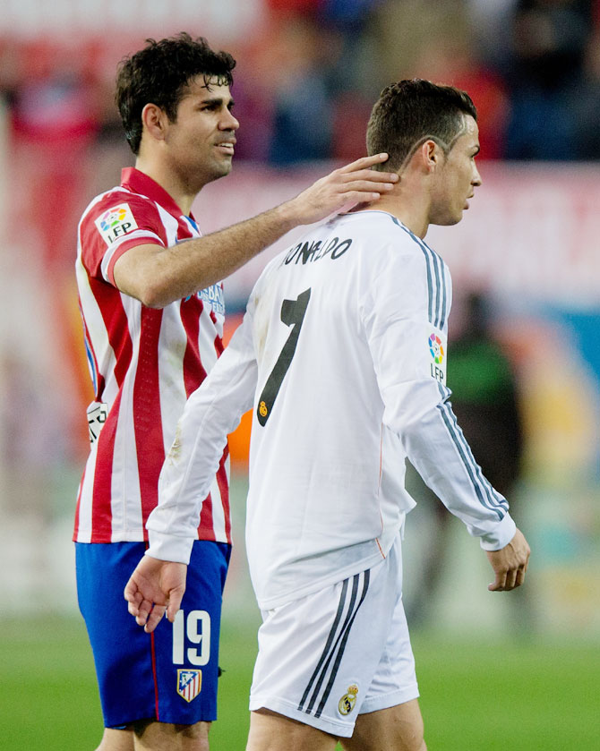 Diego Costa (left) of Atletico de Madrid and Cristiano Ronaldo of Real Madrid