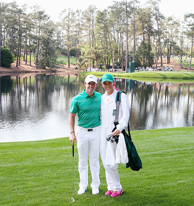 Rory McIlroy of Northern Ireland poses alongside Caroline Wozniacki