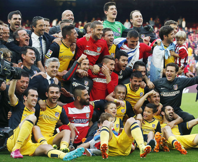 Atletico Madrid players celebrate after winning the Spanish first division title