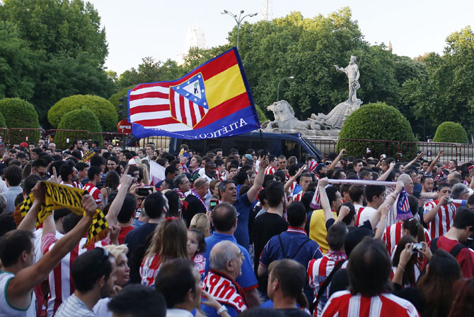Atletico Madrid supporters celebrate winning the La Liga title