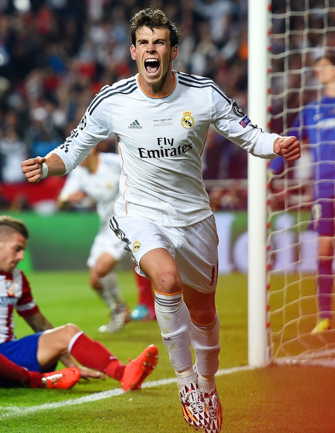 Gareth Bale of Real Madrid celebrates scoring their second goal in extra time