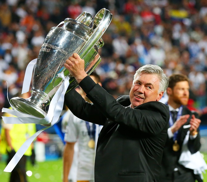 Head Coach, Carlo Ancelotti of Real Madrid celebrates with the Champions League trophy