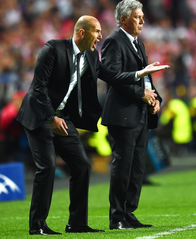 Head Coach, Carlo Ancelotti of Real Madrid looks on as Assistant coach Zinedine Zidane of Real Madrid shouts instructions