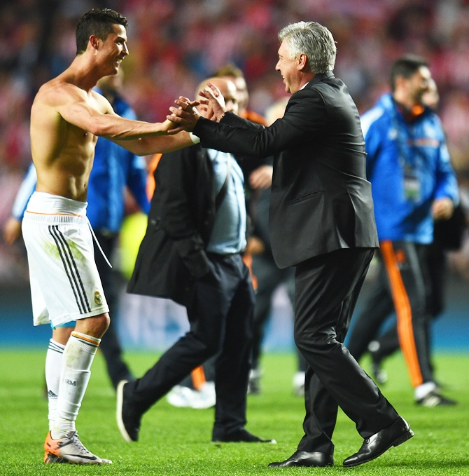 Cristiano Ronaldo of Real Madrid celebrates victory with Head Coach, Carlo Ancelotti