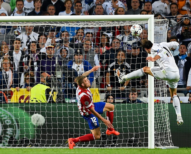 Gareth Bale of Real Madrid heads in their second goal during the UEFA Champions League Final