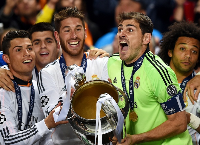 Iker Casillas of Real Madrid lifts the Champions League trophy