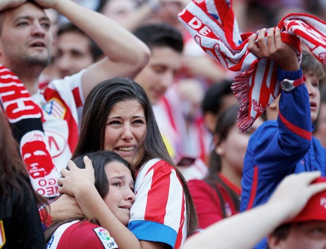 Atletico de Madrid fans react after the loss