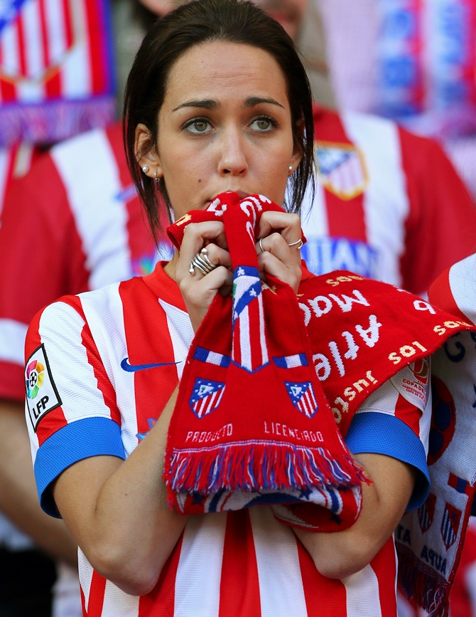 An Atletico de Madrid fan shows her colours