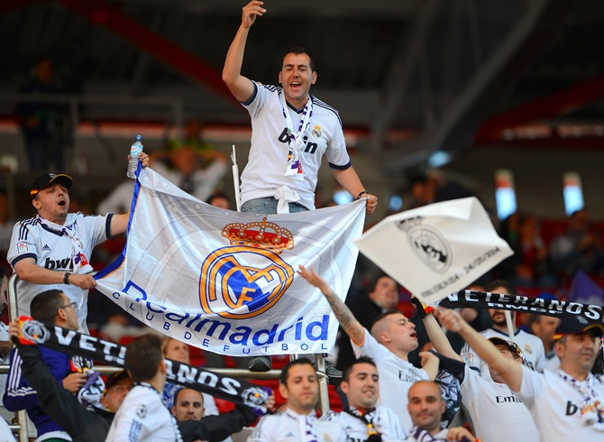 A Real Madrid fan shows his colours