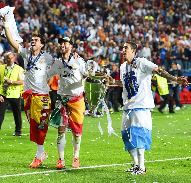 Pepe, Sergio Ramos and Ángel Di Maria of Real Madrid celebrate victory