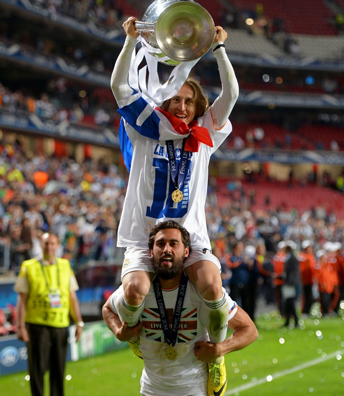 Luka Modric of Real Madrid and Alvaro Arbeloa of Real Madrid celebrate with the Champions League trophy