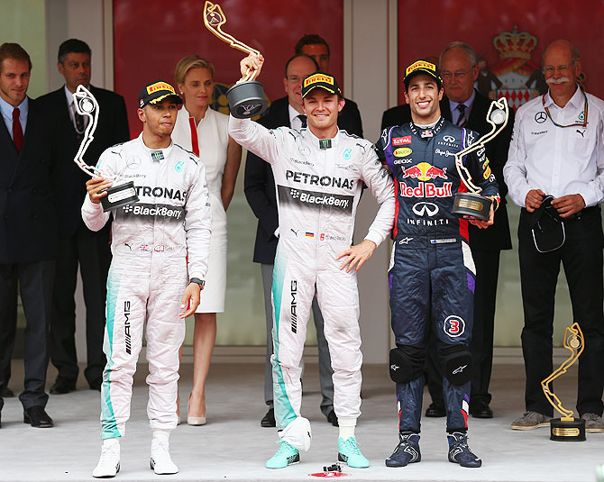 Lewis Hamilton (2nd place) of Great Britain and Mercedes GP, Nico Rosberg (1st place) of Germany and Mercedes GP and Daniel Ricciardo (3rd place) of Australia and Infiniti Red Bull Racing pose on the podium following the Monaco Formula One Grand Prix at Circuit de Monaco on Sunday