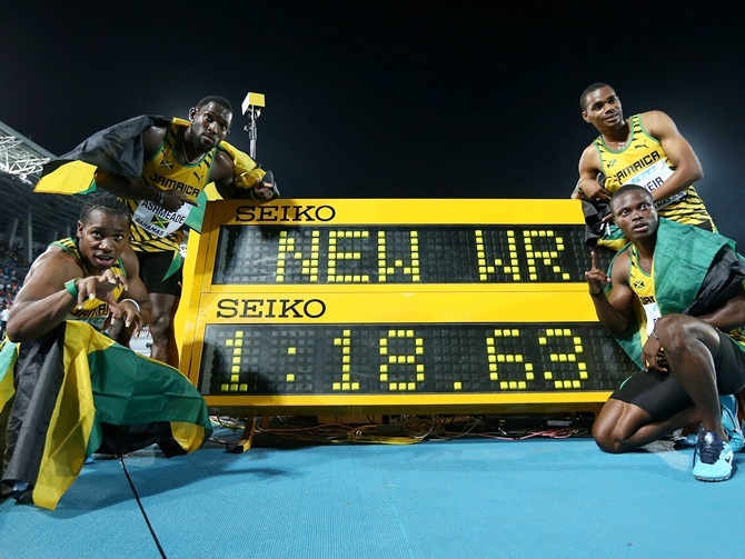 From left, Yohan Blake, Nickel Ashmeade, Warren Weir and Jermaine Brown of Jamaica pose together after setting a new world record