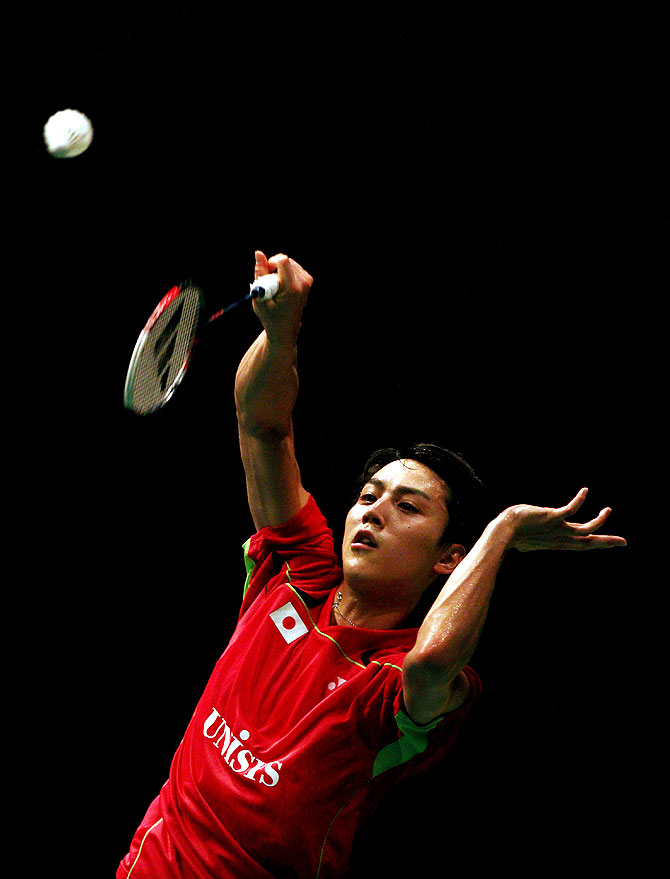Takuma Ueda of Japan plays a shot