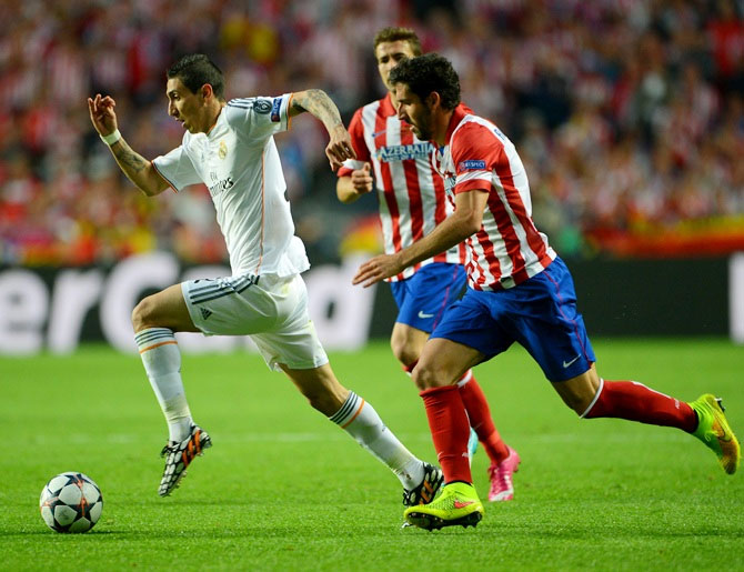Angel Di Maria of Real Madrid breaks away from Raul Garcia of Club Atletico de Madrid