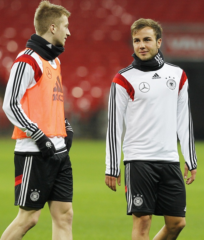 Marco Reus and Mario Goetze of Germany warm up during a training session