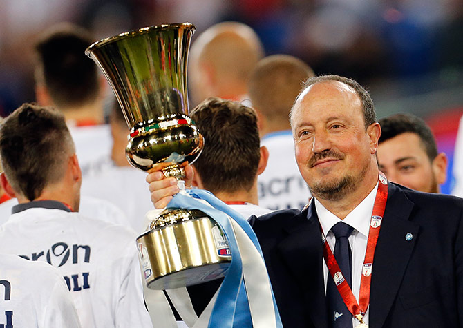 Napoli's coach Rafa Benitez holds the Italian Cup trophy