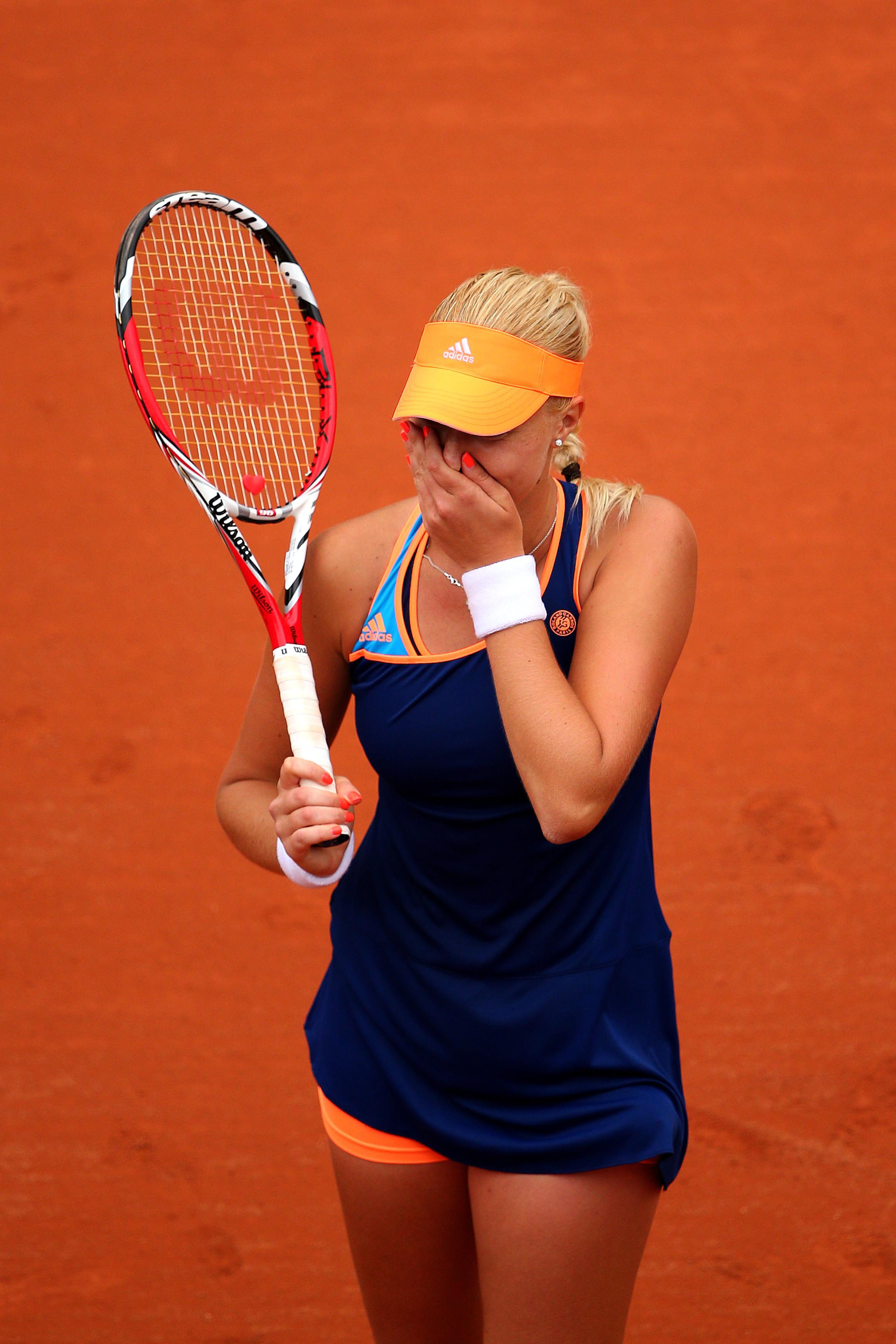 France's Kristina Mladenovic celebrates victory