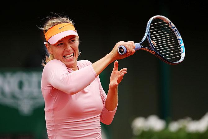 Maria Sharapova of Russia returns a shot