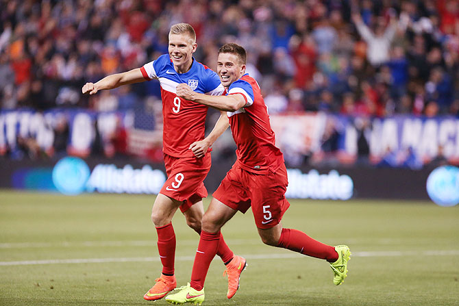 United States forward Aron Johannsson (9) celebrates with defender Matt Besler (5) after scoring a goal against Azerbaijan at Candlestick Park on Tuesday
