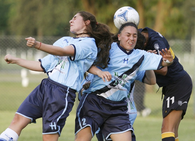 Women soccer players in action