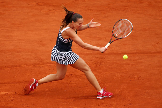 Jelena Jankovic of Serbia returns a shot against Kurumi Nara of Japan