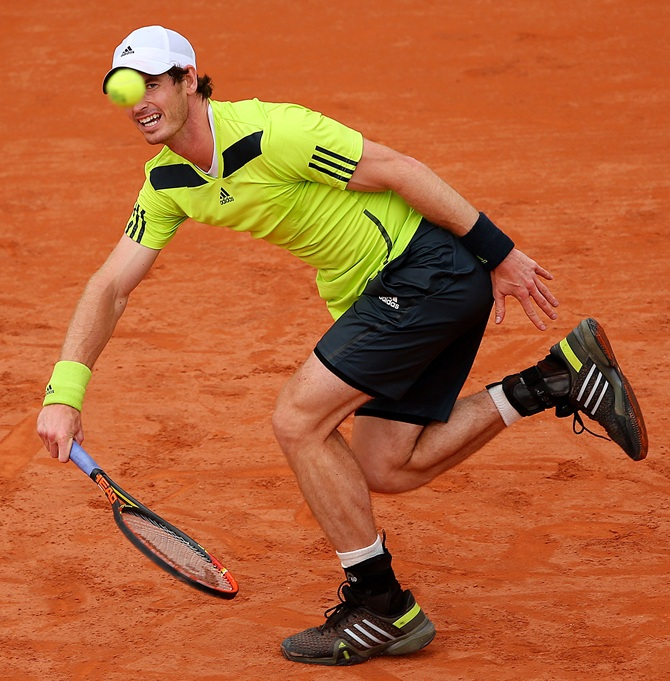 Andy Murray of Great Britain returns a shot