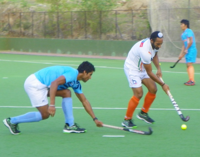 Rupinderpal Singh (in blue) and Sardar Singh practice a penalty-corner drill