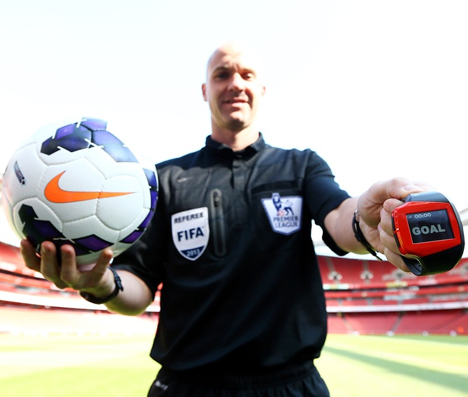 Referee Anthony Taylor tests the technology during the Goal Decision System (GDS) media event