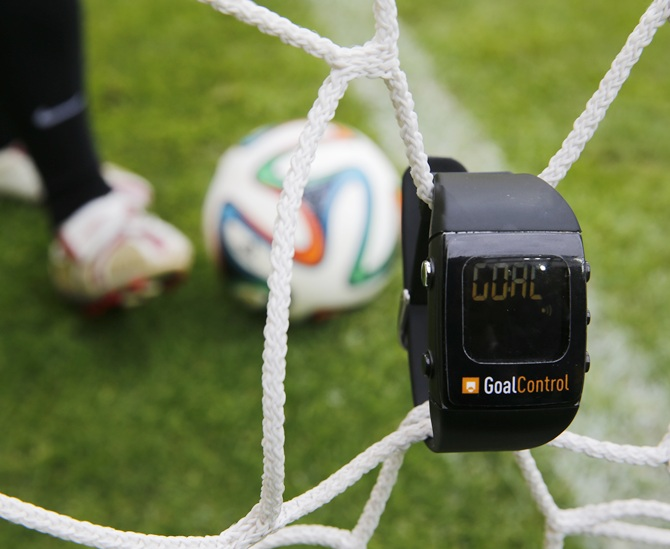 A GoalControl watch reads goal as a football rolls fully behind the goal line during a demonstration in the western German city of Aachen