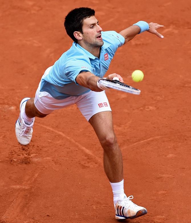 Novak Djokovic of Serbia returns a shot