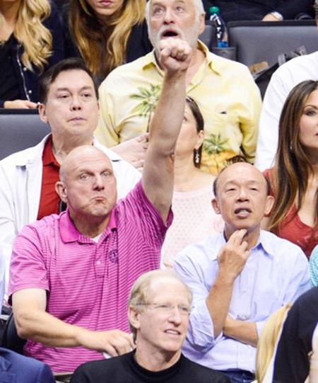 Steve Ballmer,left, attends an NBA playoff game