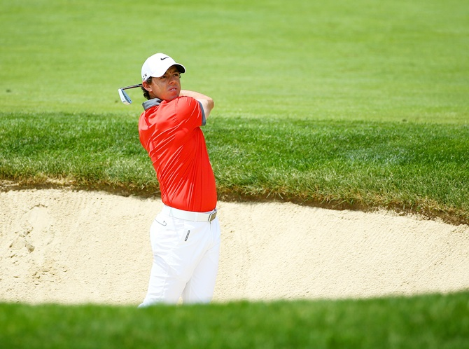 Rory McIlroy of Northern Ireland hits his second shot on the first hole during the first round of the Memorial Tournament