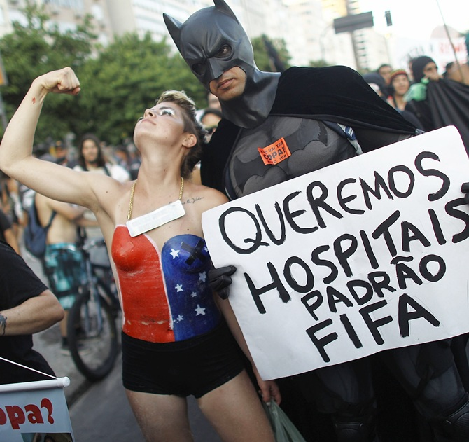 Protesters demonstrate against the staging of the upcoming 2014 World Cup